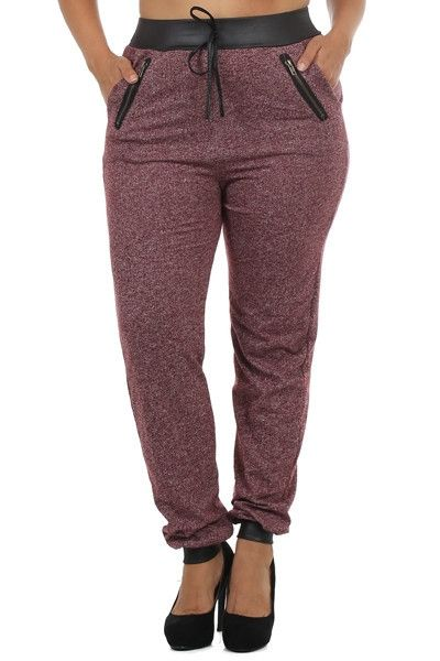 French terry peppered knit, zippered pocket, cuffed, jogger pants with drawstring detail and faux leather trim. 92% Polyester 8% Spandex Made in China