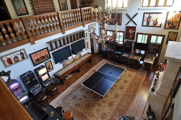 Centrally located, well-lit, and flanked by loggia, this game room beckons and compels visitors with great views to the backyard baseball field. Adjacent is a stairwell that leads to the wine cellar.