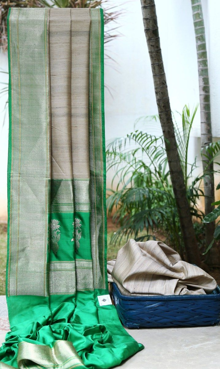 Natural Beige coloured Benares Tussar Silk sari with a contrasted green and zari pallu, border and blouse
