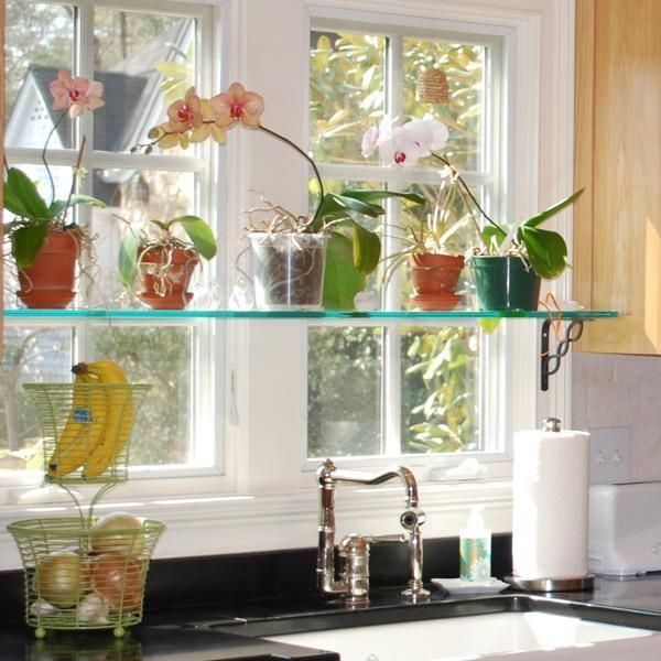 Small stationary windows or large window designs with sections that do not open are ideal for home decorating with glass shelves