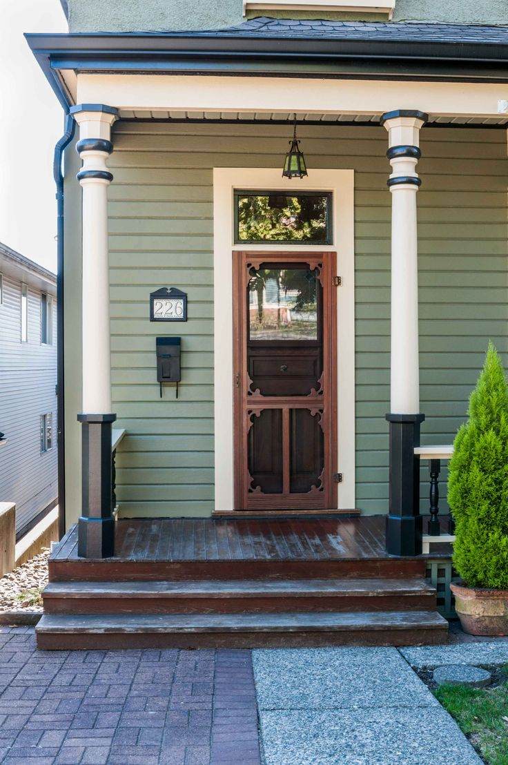 Cute little green heritage home that was painted by Warline Painting.