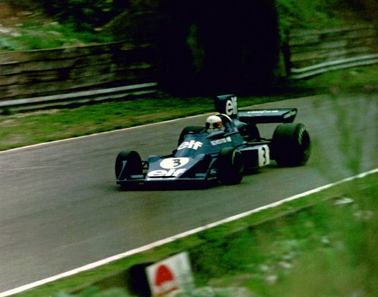 Jody Scheckter - Tyrrell 007 heads towards Hawthorn Bend at the 1974 British Grand Prix, Scheckter was the eventual winner.