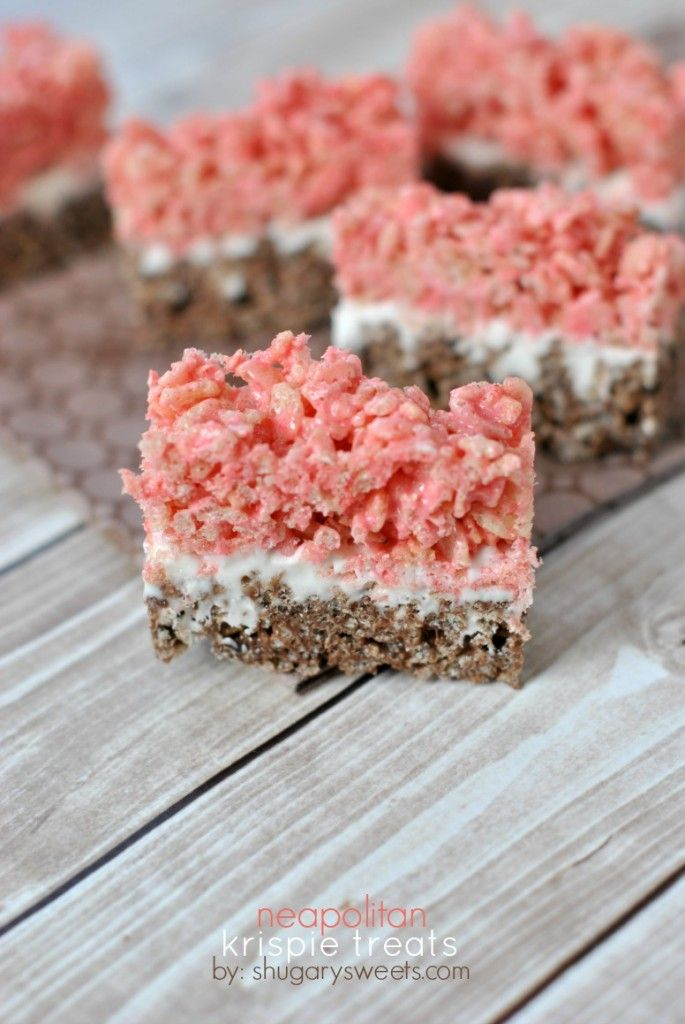 Triple layer Neapolitan Krispie Treats....chocolate and strawberry with a marshmallow frosting center!!