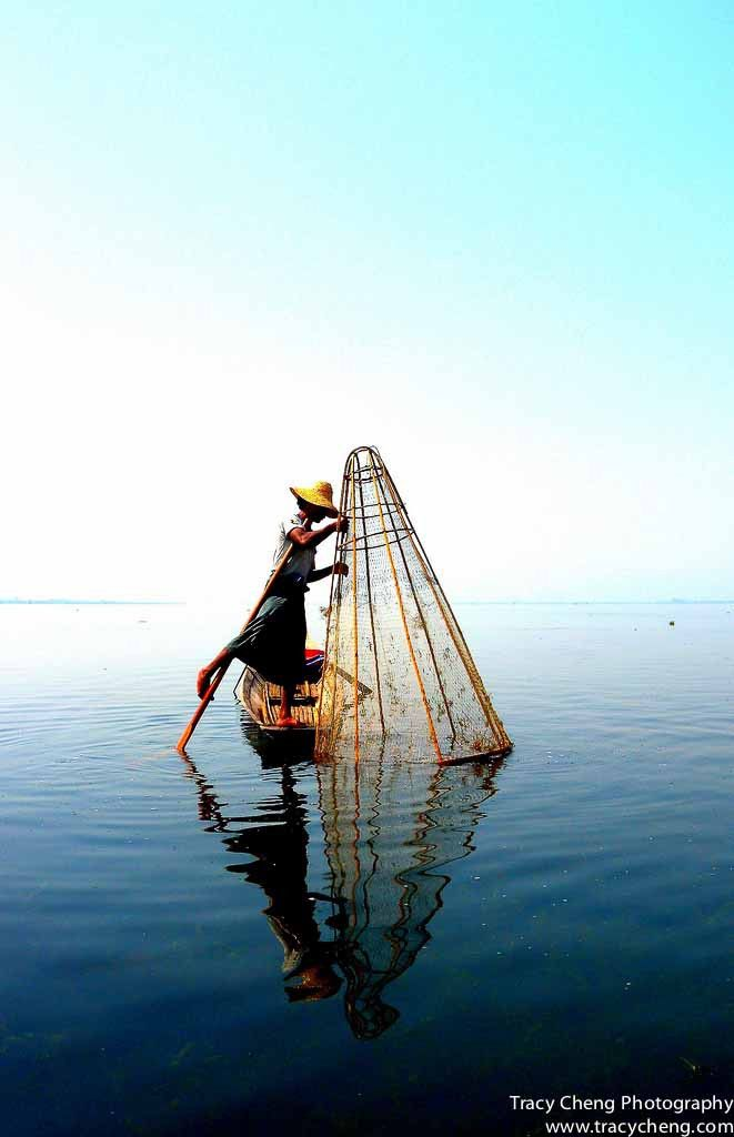 Featured on the front cover of National Geographic Traveller March/April 2012 issue, the famous one-legged fisherman of Inle Lake, Myanmar, shows off his skills while trying to trap fish. FYI! Photo t