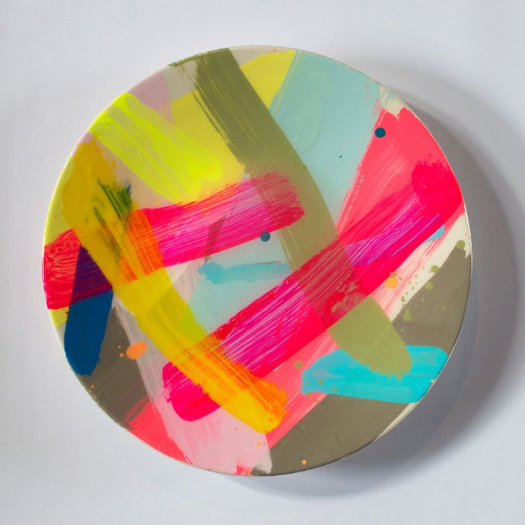 These unique hand painted ceramics are made from quality high fired stoneware and finished with a gloss apoxy resin. Each of these is a unique artwork in its own right, painted by renowned abstract artist Rowena Martinich. These plates are decorative objects rather than intended for food. Hand made in Melbourne.Plates are 28cm in diameter, stamped with Martinich