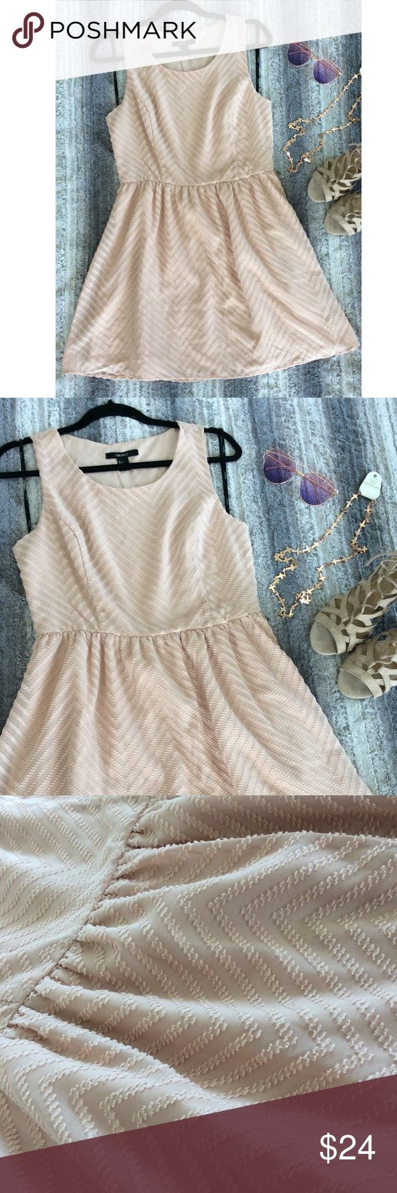 Forever 21 Blush Pink Zig Zag Dress Pre-loved sleeveless, blush pink dress with tonal zig zag design. Has pulling along back seams, as pictures show. 100% Polyester Forever 21 Dresses