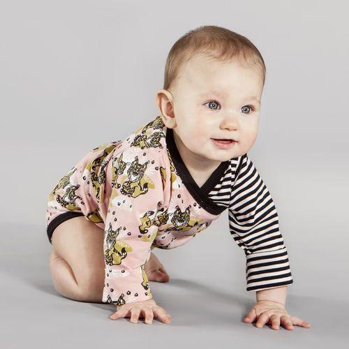 wraparound bodysuit for the newborn. Powder pink ILVES print designed by Finnish artist Annika Hiltunen