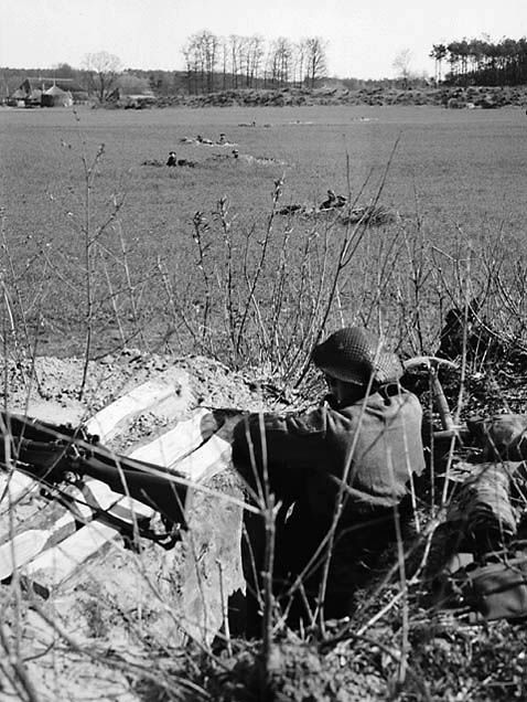 Black Watch (Royal Highland Regiment) of Canada troops in slit trenches, 8 Apr. 1945, Holten, Netherlands.