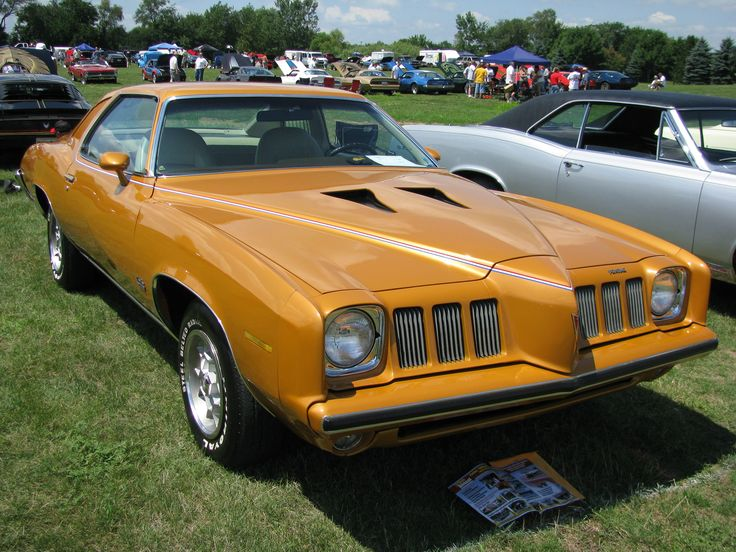 """The first Grand Am: introduced during the days immediately before the first U.S. """"gas crisis"""" of 1973, this model (coming as a 2-door coupe or 4-door pillared sedan and standard 400-4 barrel {& available 455, both of which could be specified with an available 4-speed manual}) was originally intended as a sort of upscale, European-influenced GTO replacement. The NACA-scooped hood was an option, as were the 15-inch honeycomb wheels shown."""