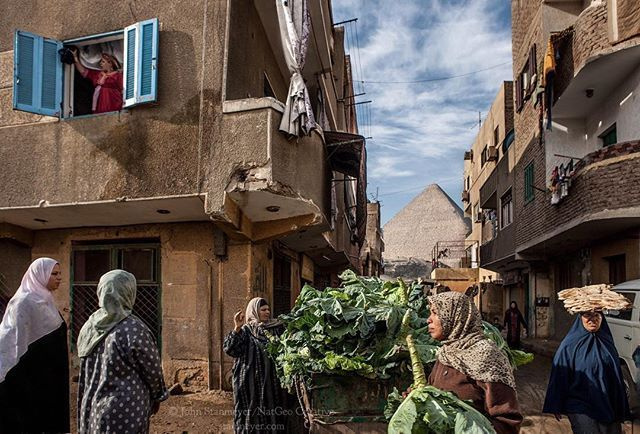 Photo by @johnstanmeyer • Giza ~ Cabbage vender arrives between narrow alleyways, bringing out many buyers, shopping for dinner before the splendor of the Great Pyramid's of Giza, Egypt. Such a poetic scene has replicated itself for centuries within the land of the pharaohs. • Follow my latest project, @bridging.stories, here on Instagram. Thank you so much, @JohnStanmeyer • @natgeo @natgeotravel @natgeocreative @thephotosociety #egypt #giza #gizah #gizeh #pyramid #gizapyramid…