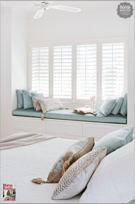 Aqua and beige velvet touches bring a luxurious calm to this bedroom Window idea for main bedroom