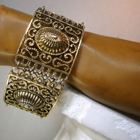 Medieval Gold Filigree Link Bracelet, Classic and Timeless Design in Oxidized Gold Ornate Shiny Metal 1980s Unused sample from my archival collection The bracelet is 7 1/2 long by 1 1/4 wide ( 19.05cm x 3.175cm ) Gift worthy item  -------------------------------------------------------------------- PLEASE NOTE*** I ONLY ship to your paid invoice address. Please Email any questions..I answer 7 days a week, except when I am sleeping!! VINTAGESTARRBEADS www.vintagestarrbeads.etsy.com