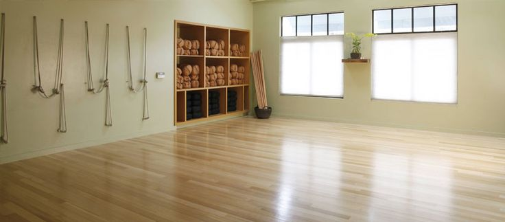 Home Yoga Studio Design Ideas saveemail Bamboo Floors Built In Shelving Pilates Studio Pinterest Sliding Doors Built Ins And The Studio