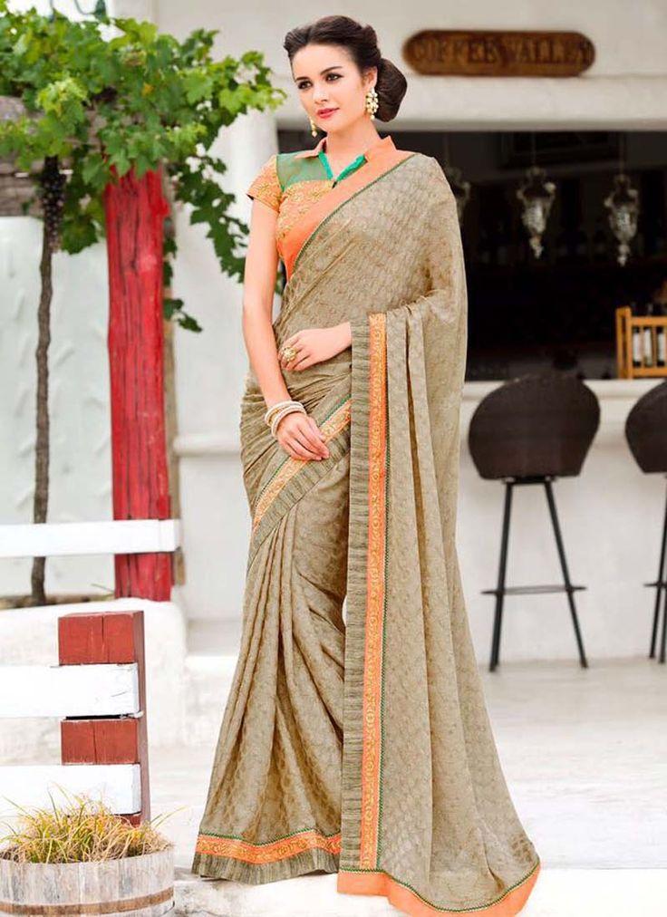 100 % Original Color: Grey Fabric: Bangalore Silk Work : Embroidery Blowse: Satin Chiffon with self pettern -Orange