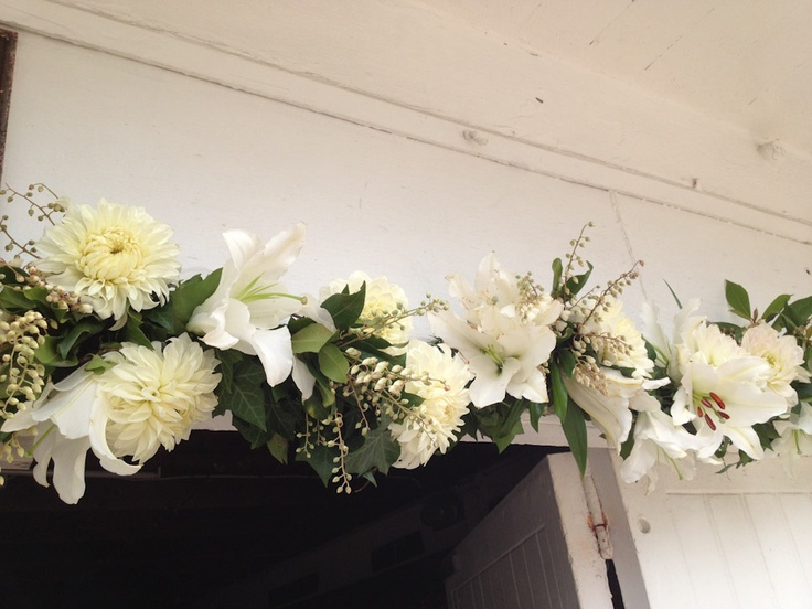 garland using dahlia, oriental lilies and flowering clethra- dusty miller designs