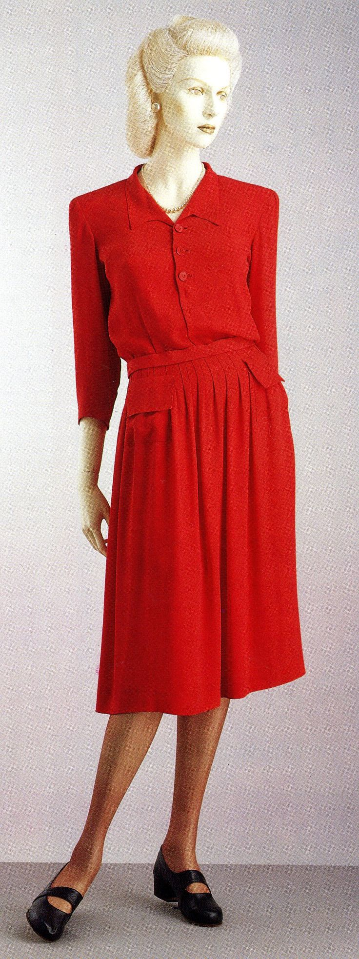 """""""Utility"""" dress, c.1940s. The British government introduced the Utility Clothing Scheme to address the shortage of labor and materials during and after WWII. Silhouettes were kept simple, but many were in fact commissioned from leading designers, such as Hardy Amies and Norman Hartnell."""