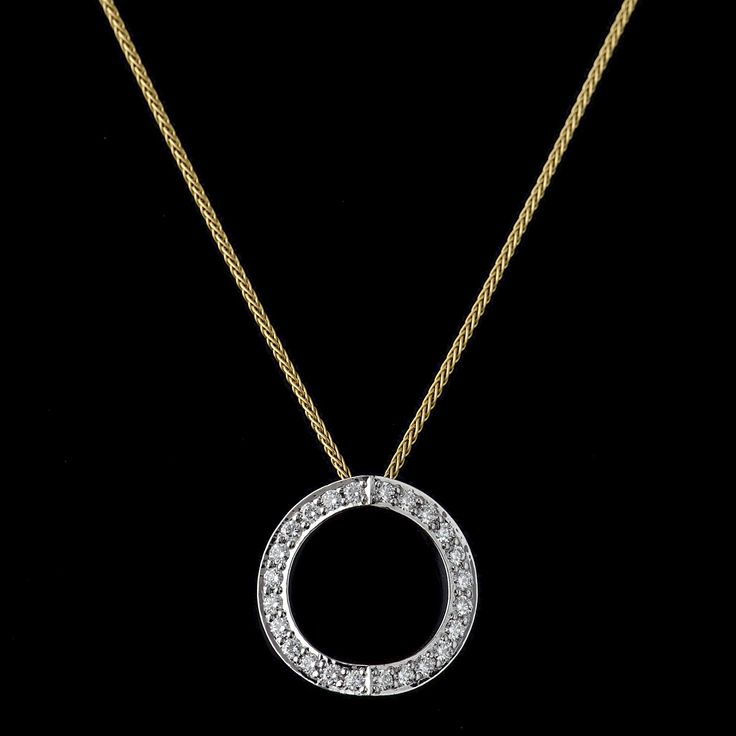 Diamond set pendant from our 'Hidden Heart' collection. Appearing as a circle the secret of the heart is only revealed to the wearer when viewed from above.