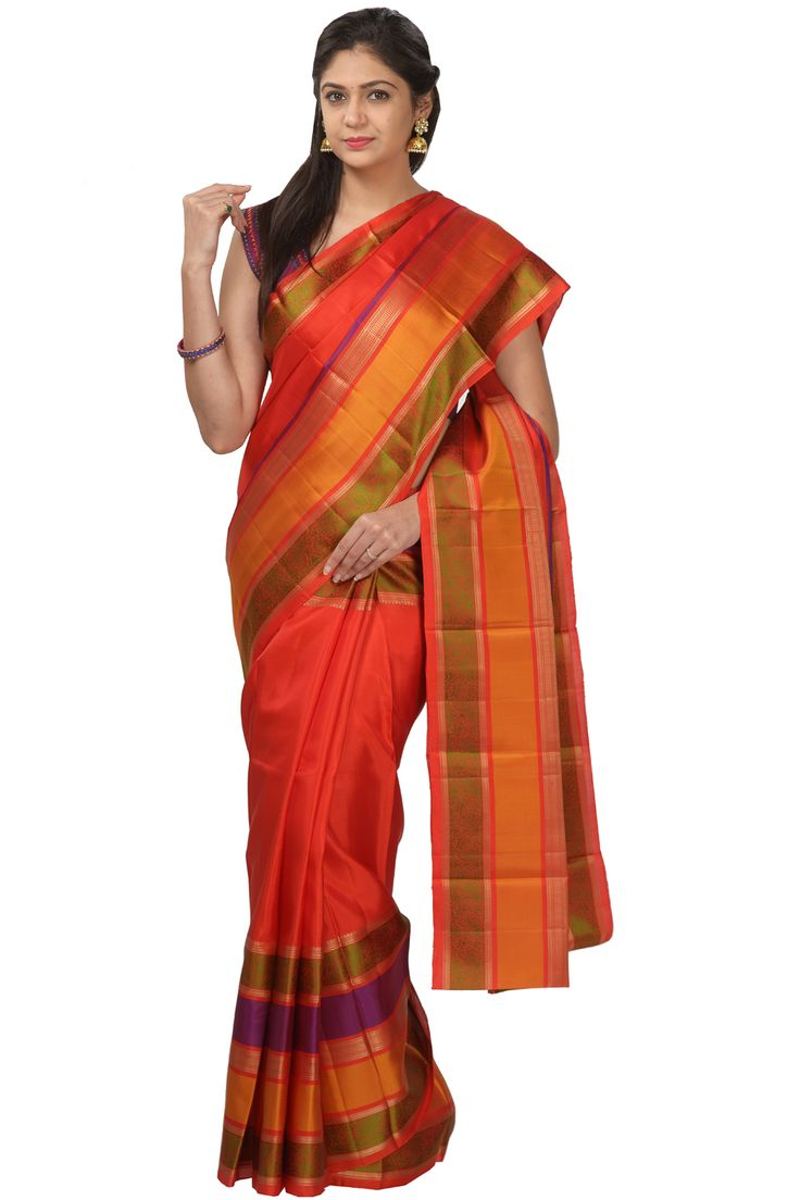 #Kalanjali Exclusive #Handloom#saree #A red kanchi silk saree with multi coloured skirt border. Beautifully woven peacock motifs in thread. It comes with red blouse piece with thread floral buties all over.