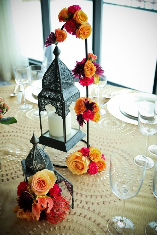 Moroccan styled lanterns and roses.