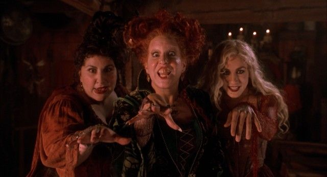 The Sanderson sisters/witches -- Mary (Kathy Najimy), Winnie (Bette Midler), and Sarah (Sarah Jessica Parker) -- attack in the prologue set in 1693. -- Hocus Pocus: Blu-ray + DVD Review
