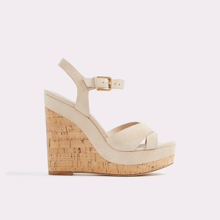 Madyson A stunning cork-covered wedge heel marries slender leather straps on these platform sandals. Fastened by a gilded buckle, they are a chic and feminine way to add height to any look.