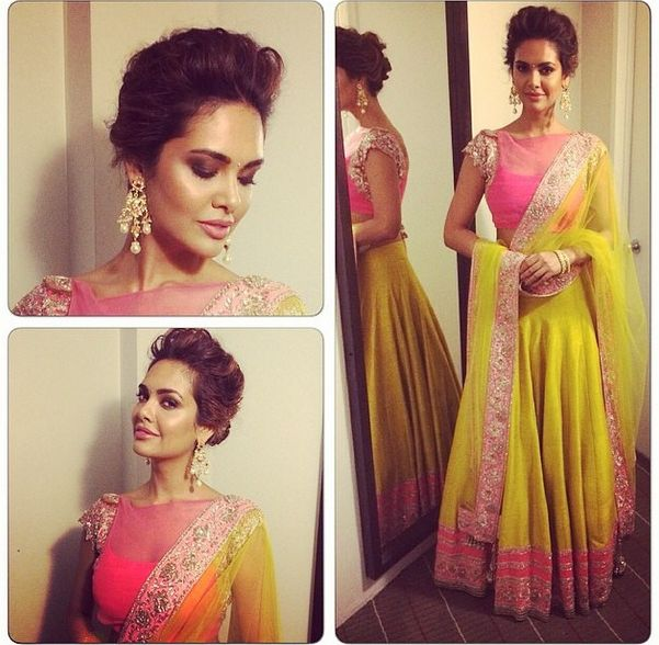 Esha Gupta in Manish Malhotra Lots of neons and fluros in 2014 and who better to show us how it's done than Esha Gupta in this fluro yellow and pink outfit by Manish Malhotra. Such a fun colour combination - perfect for a mehendi or sangeet! We love though that she dressed up the outfit with an updo, subtle makeup and some statement earrings. Definitely a highlight from 2014! Indian wedding - Bollywood wedding #thecrimsonbride