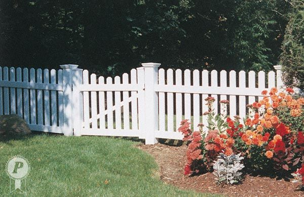 Dog Ear Picket Fence With Scalloped Gate Outdoors In