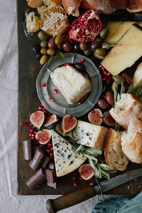 rustic cabin Christmas..figs, pomegranates, chocolate, cheeses, honeycomb,olives..baguette