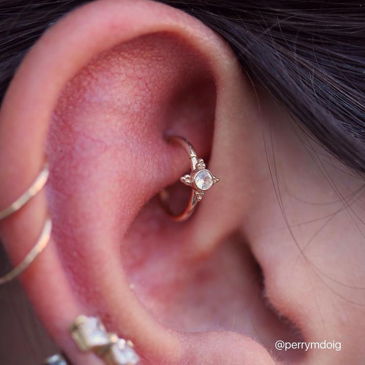 "Healed rook piercing upgrade featuring a white sapphire in gold ""Mini Kandy"" ring, from @bvla"