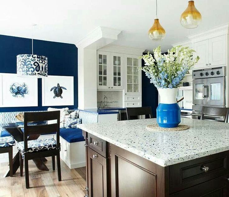 Nautical kitchen white cabinets light counter tops dark block navy walls bench seating at - Kitchen counter decoration ...