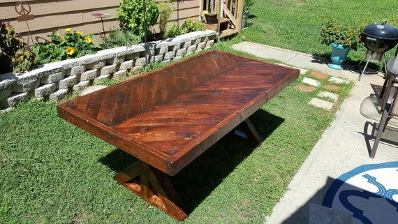 Rustic wood dining table. Herringbone pattern on top. X-brace legs, with cast iron rod brace. Super strong! Measures 75 x 36 inches.  Red Oak stained Pine.  Seats up to 10 people.  Local pick up. No shipping.