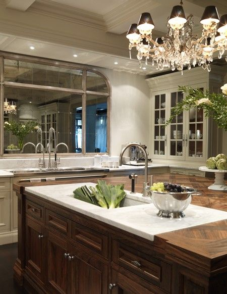 Love this marble sink/prep area set into this gorgeous parquet wood top- Mirror instead of window over sink- designed by Julie Charbonneau