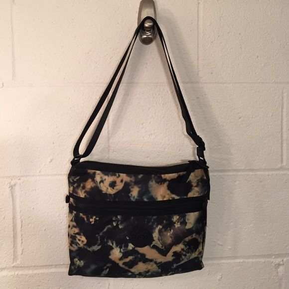"""Kipling Washed Out Floral Bag Black with muted washed out flowers and leaves. 1 outside zip. 2 separate top zips. One  side with inner zip pocket and key holder and other side with phone/pen holders. adjustable strap to 51"""" top to bottom of bag. Good travel bag. EUC Kipling Bags Crossbody Bags"""