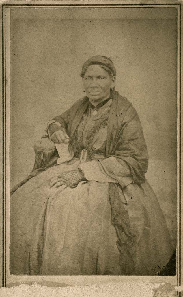 """June 28, 1863: While James sat on a porch in a thunderstorm, a female slave, who probably looked like the woman in this photograph, told him about the white Confederate sympathizers leaving the area. """"Aunt Sukey"""" African American slave of Robert B. Smith family. Carte de visite by T.D. Saunders, Lexington, MO, ca. 1860. Missouri History Museum."""