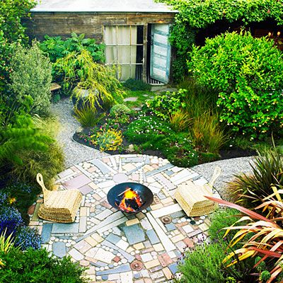 Recycled materials and colorful, graphic plants add whimsical punch to Bob Buchbinder and Lynn Pearson's San Francisco backyard. In the center, landscape designers James Pettigrew and Sean Stout (organicmechanics.us) created a one-of-a-kind patio that's 16 feet in diameter and made of granite remnants—mostly dumpster finds—mixed with sewer caps and bricks. In its center is a wood-burning firepit fashioned from an old metal wok that sits on a steel base