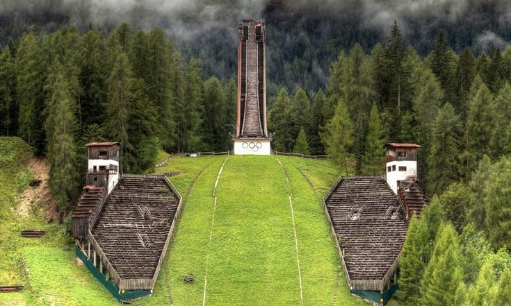Olympic Stadiums After the Games Ski Jump Tower, Cortina D'ampezzo, Italy, 1956 Winter Olympics Venue   Bobsled Track, Sarajevo, 1984 Winter Olympics Venue   Olympic Canoe And Kayak Slalom Center, Athens, 2004 Summer Olympics Venue   Main Swimming Pool, Athens, 2004 Summer Olympi