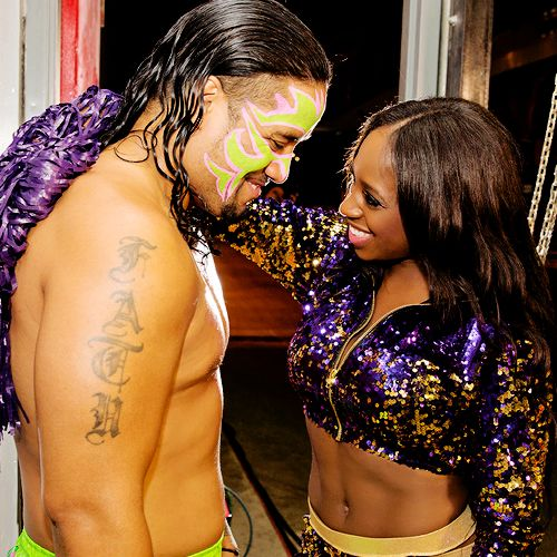 Jon Fatu (Jimmy Uso) sharing a moment with his wife Trinity McCray-Fatu (WWE Diva Naomi) backstage at a live event
