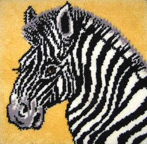 """Zebra latch hook rug kit. 30"""" x 30"""" (76.2x76.2 cm) kit comes complete with chart, 3.3 mesh latch hook canvas, pre-cut yarn is 2 x 3 ply acrylic rug yarn (which is equivalent to 6 ply) and complete instructions."""