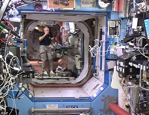 Nasa astronaut Jeff Williams floats inside the Bigelow Expandable Activity Module (BEAM) Monday, June 6, 2016. The crew of the International Space Station entered the newly expanded pod Monday to collect air samples. As is customary, they wore goggles and cloth masks in case of floating debris