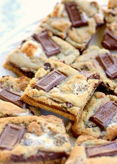 S'mores Cookies - graham crackers topped with chocolate chip marshmallow cookie dough and topped with Hershey squares. the-girl-who-ate-everything.com