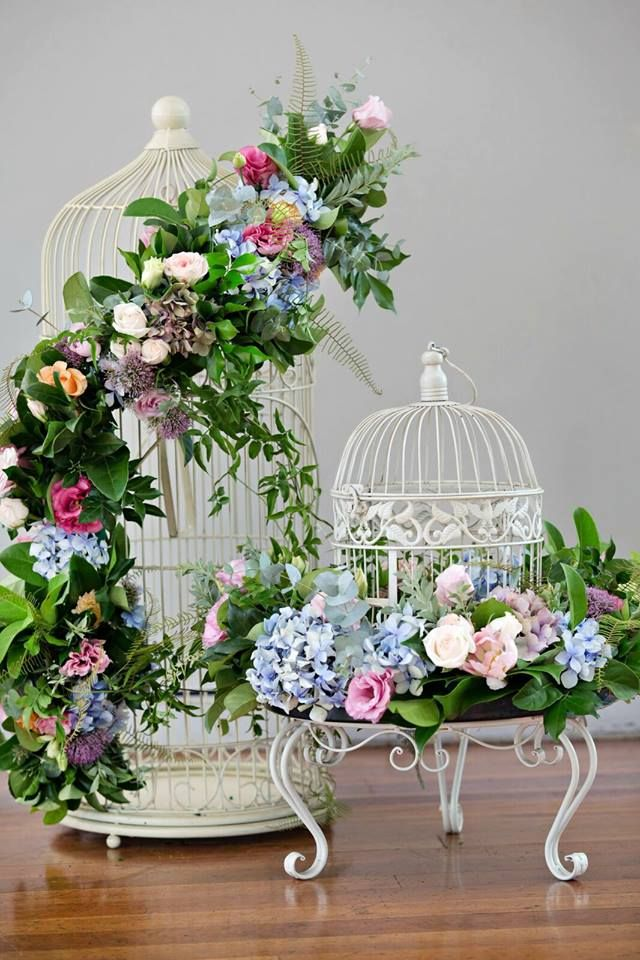 Flowers and bird cages are the perfect pair.