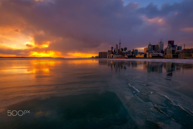 Frozen Lake Sunset - Beautiful #sunset light up the frozen lake in Toronto. This was taken from Polson Pier yesterday. Hope you like it!