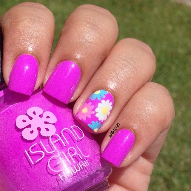 Gorgeous color! And I love the flowered accent nail! Very summery :)