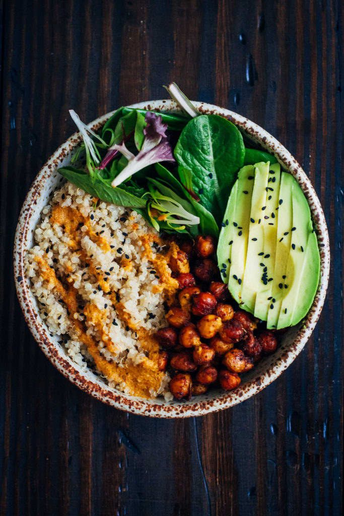 What you'll need:• 1/2 cup cooked quinoa• 3/4 cup cooked chickpeas• Handful torn kale• 1/2 avocadoToss the chickpeas with whatever spices you have (salt, pepper, paprika, chili powder, turmeric, etc...) and bake them until they're nice and crispy. Top your quinoa bowl with the chickpeas, greens and avocado. A squeeze of lemon, a drizzle or balsamic, or a dab of hummus on top will do the trick. Get the recipe.