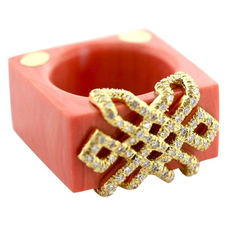 HENRY DUNAY Coral and Diamond Ring - US - Contemporary  Chic and chunky Henry Dunay cocktail ring hand carved form one piece of coral embellished with a geometrical 18k gold design inset with .61 carats of diamonds