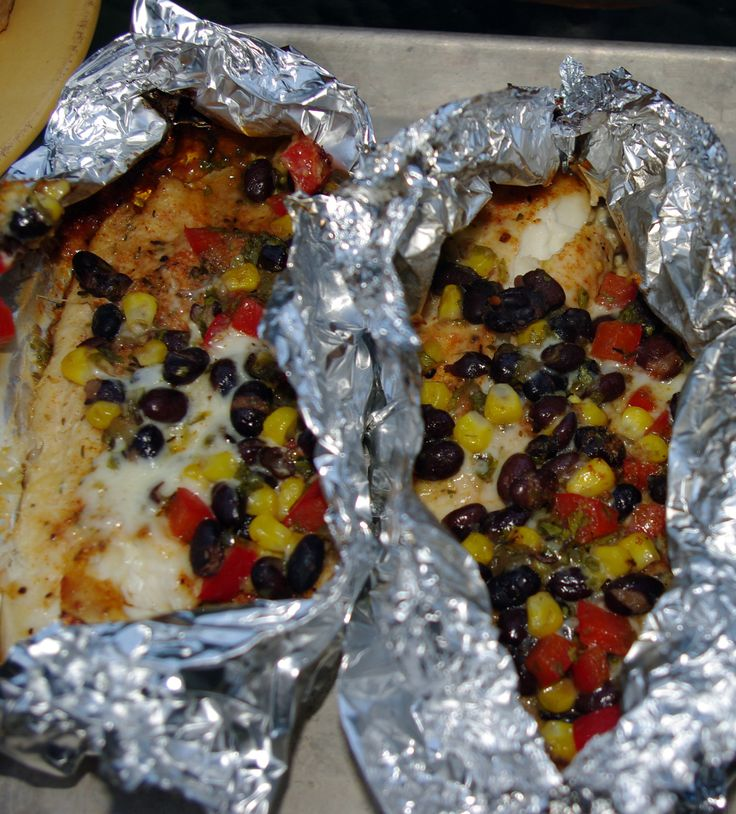 Grilled Tilapia in foil packets with black bean, red pepper, green chile,