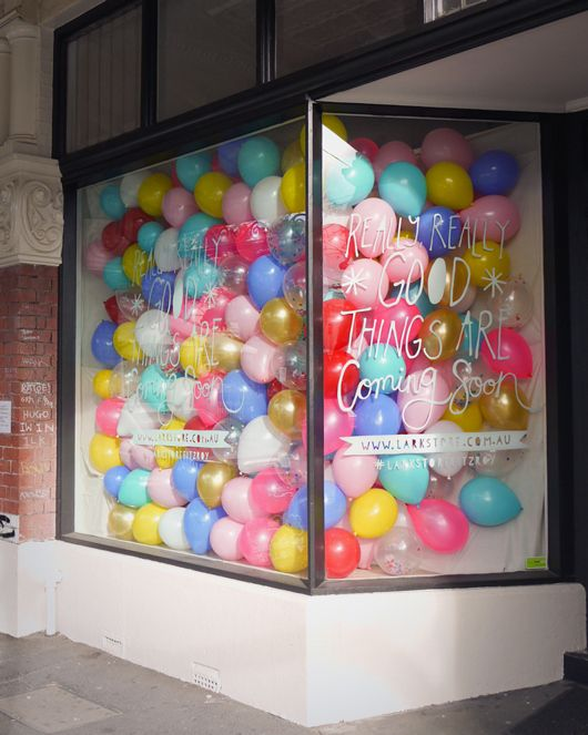 balloon window display (during construction) I actually really want to do this with our one window downtown... maybe our next big birthday?? I dunno. its so bright and fun!