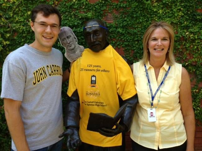 Mark Bartholet (G2011) and Rebekah (Bookwalter) Thompson (1988), staff members at the Jesuit-staffed St. Peter Catholic Church, celebrate College Colors Day with St. Ignatius and John Carroll.
