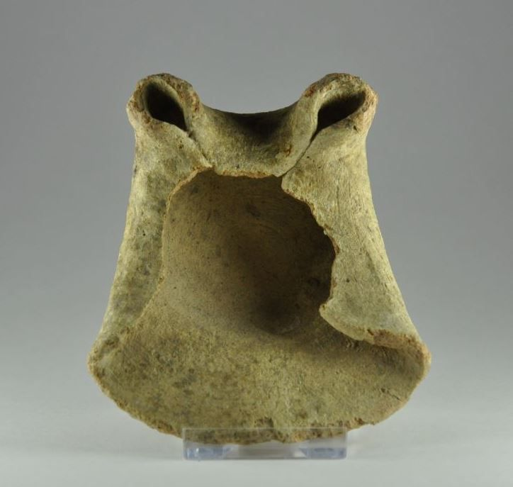 Phoenician oil lamp, Punic pottery oil lamp with two wick holes, 2nd-1st century B.C. Phoenician oil lamp, Punic pottery oil lamp with two nozzles, saucer lamp, high flat base, string cut. This kind of lamps was produced after the fall of Carthage in 145 B.C. somewhere in the interior of the country, their form originates from the Eastern saucer lamps and was in use from 7th to 2nd century B.C. These lamps were exported to the Mediterranean and imitated locally, 8 cm