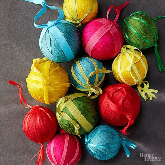 Jewel-tone ornaments add instant bling to your Christmas tree. Wind strands of 5/8 inch raw silk ribbon around a 2- or 3-inch foam ball and secure the ribbon with hot glue. Wrap pieces of satin, velvet, or grosgrain ribbon (5/8 inch or narrower) around the ball at equal intervals, securing the ribbons' ends with hot glue at the bottom of the ornament. Create a hanging tassel by cutting and stacking three 6-inch pieces of ribbon, knotting them in the center, and gluing the ribbons to the…